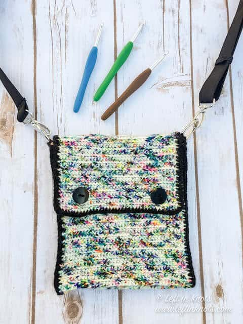 A small crochet crossbody purse made with hand dyed yarn