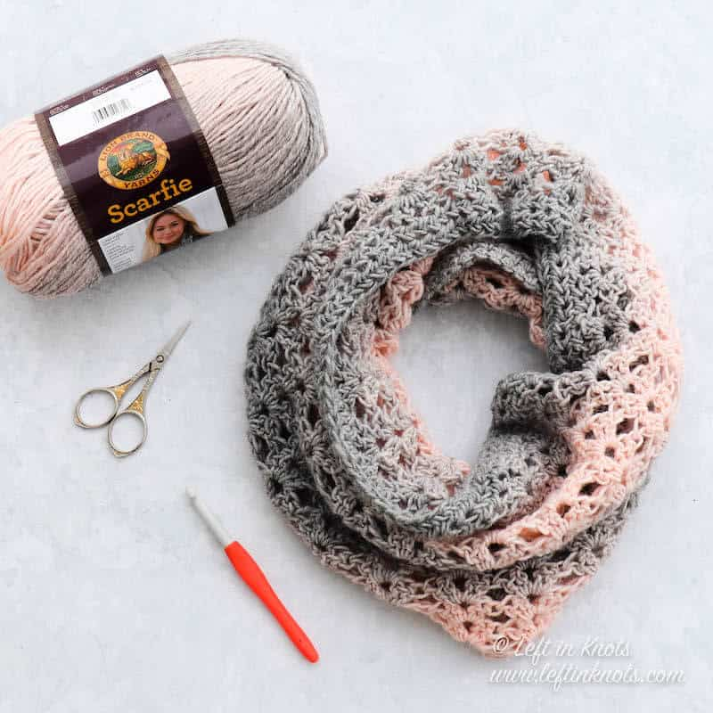 A pink and gray crochet cowl using the iris stitch