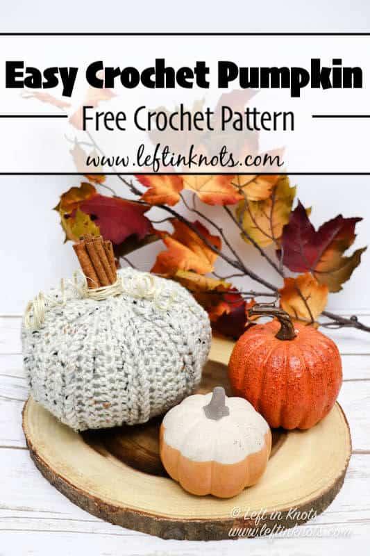 A crochet pumpkin with cinnamon stick stem