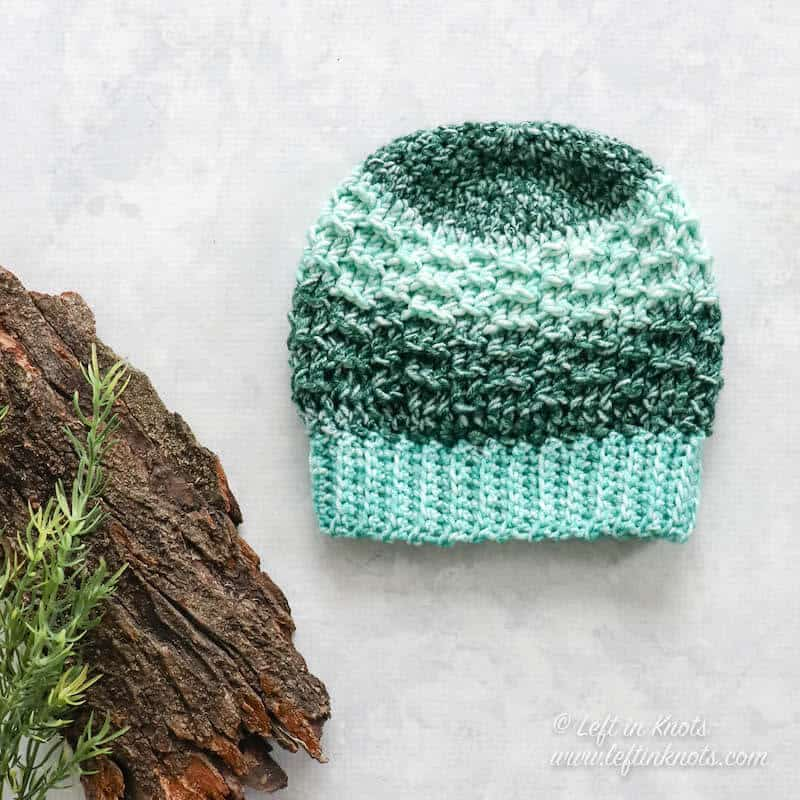 An ombre unisex crochet beanie in sizes for baby, child and adult