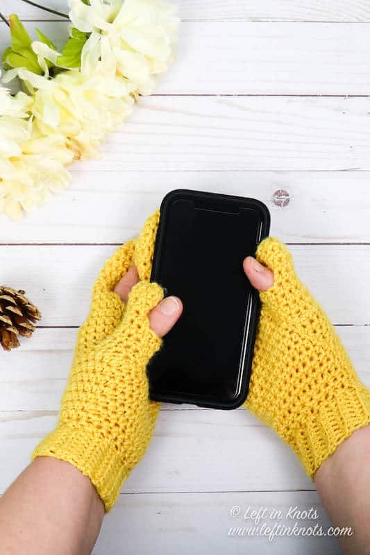 Yellow crochet mittens with finger holes for texting