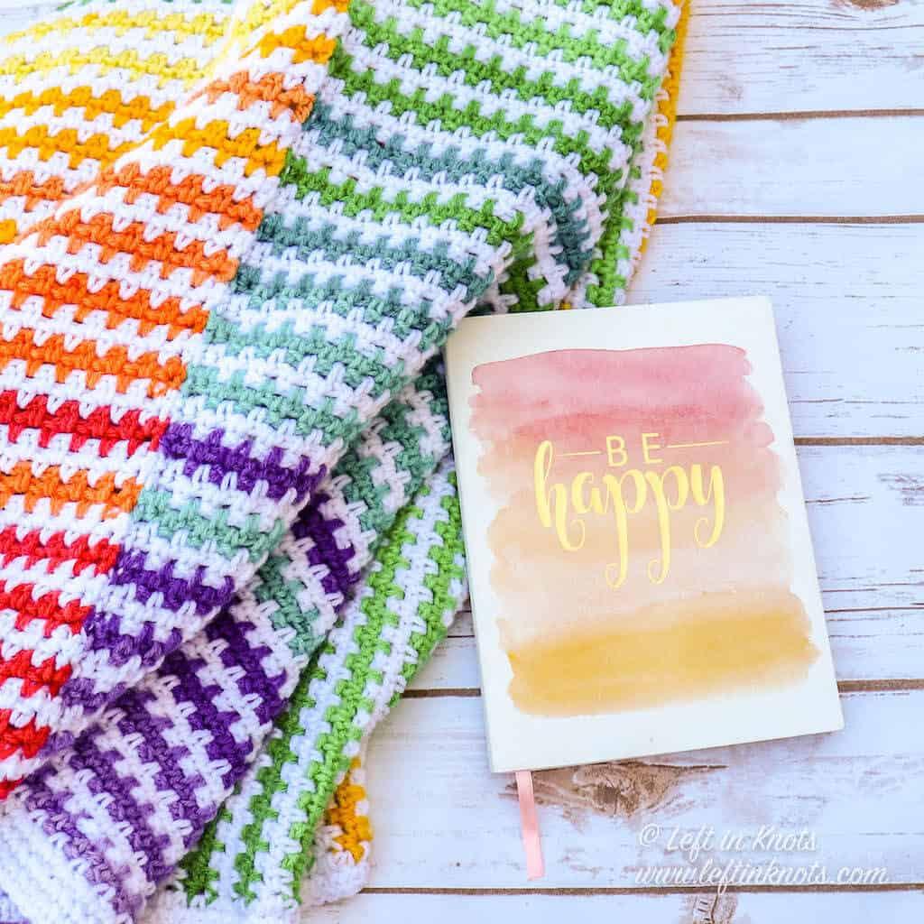 A rainbow striped crochet baby blanket
