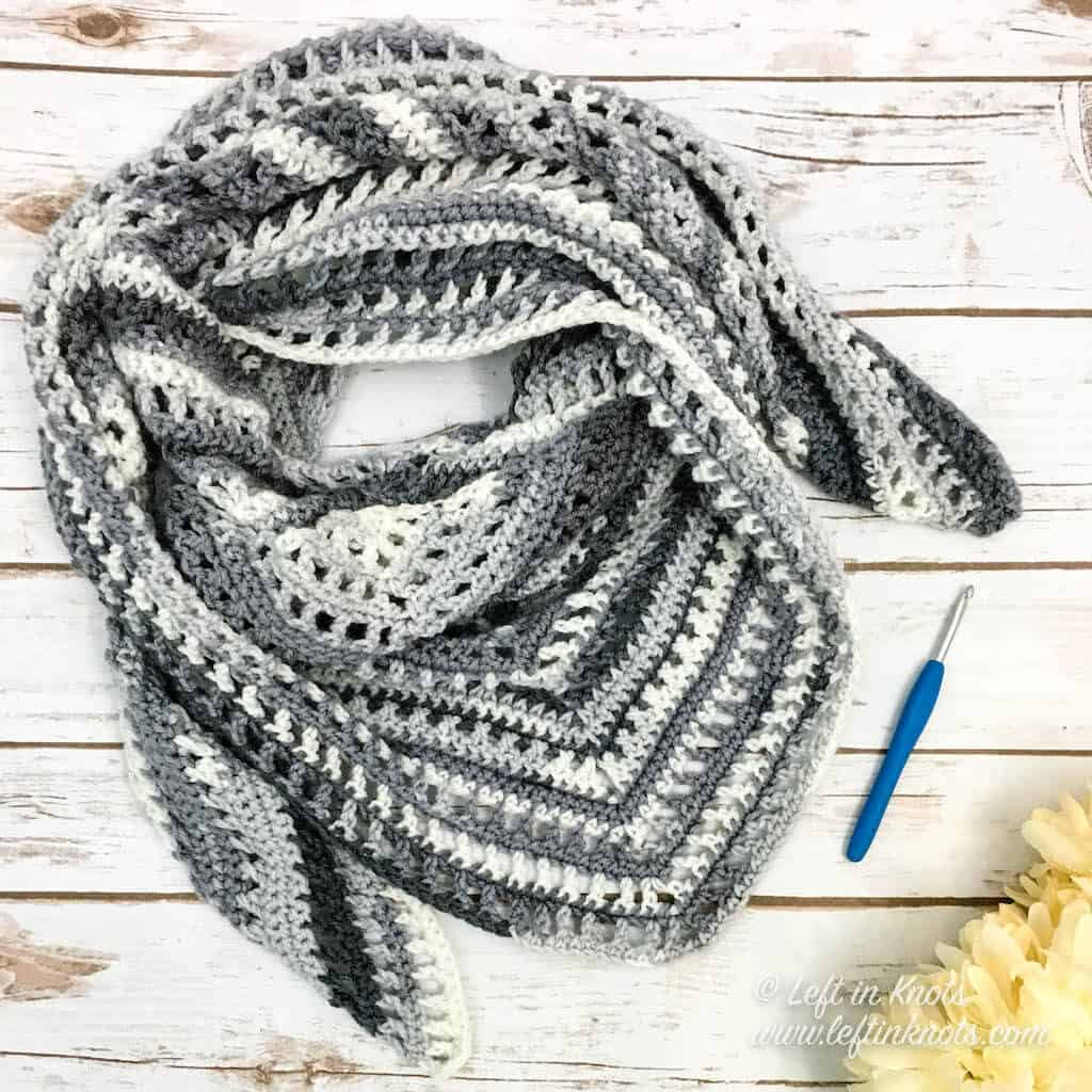 An easy crochet shawl made with gray and white yarn