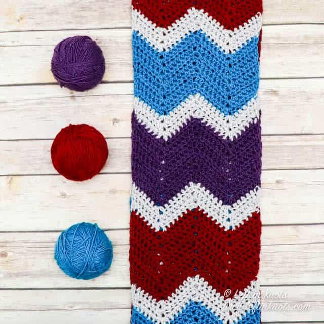 A crochet chevron scarf made in jewel tone yarn