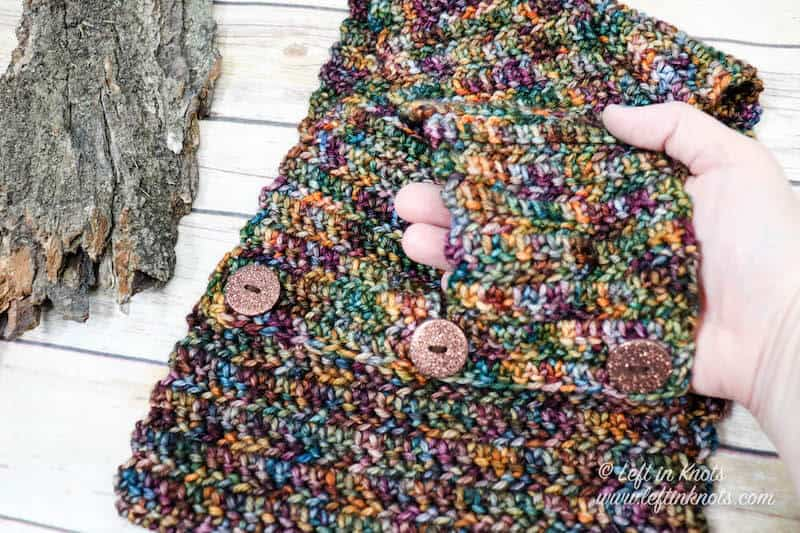 A modern braided crochet cowl made with hand dyed yarn