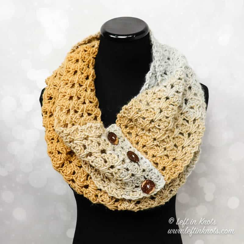 A buttoned crochet infinity scarf made with the V stitch