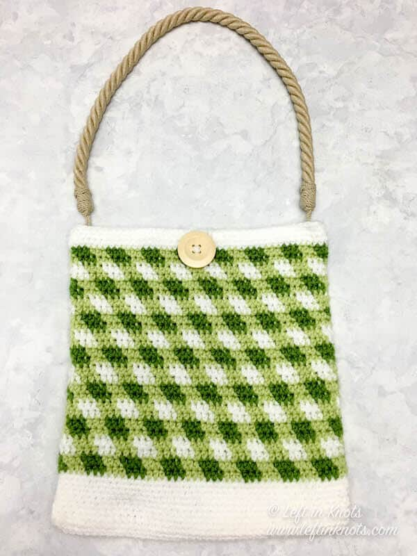 A green gingham plaid crochet market bag with rope handle