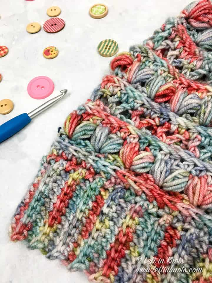 A crochet beanie made with the heart puff stitch