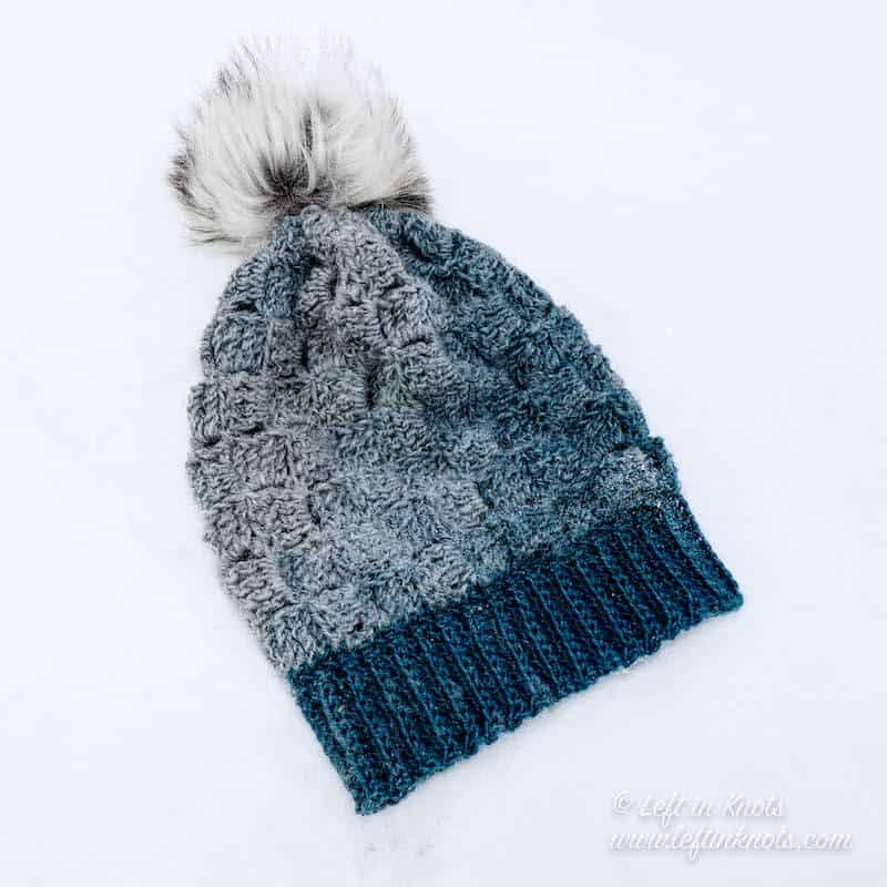 A blue and gray crochet beanie made with Lion Brand Scarfie yarn
