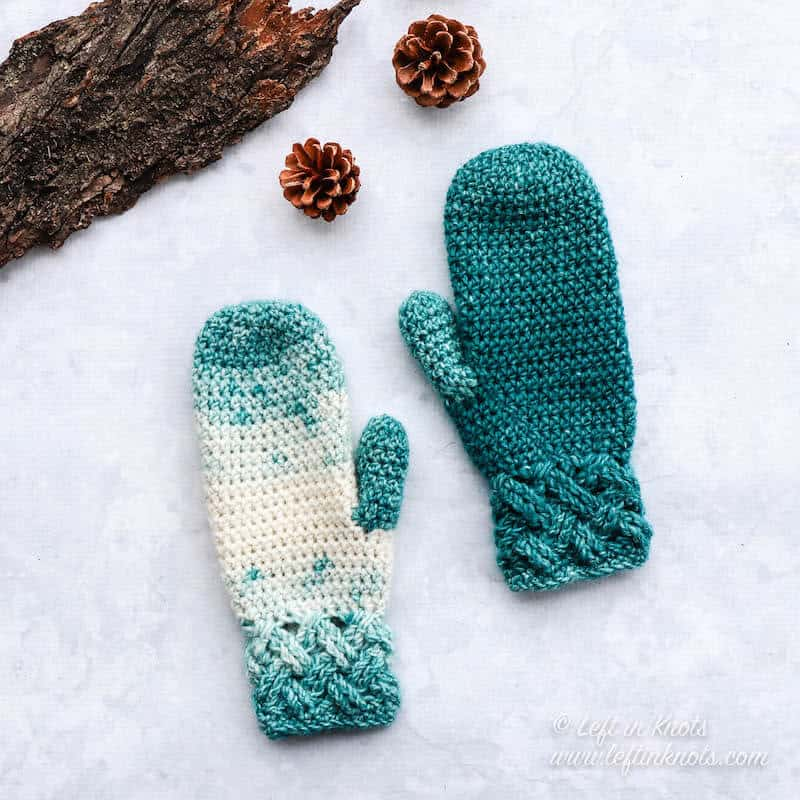 Teal and cream crochet mittens made with the Celtic weave stitch