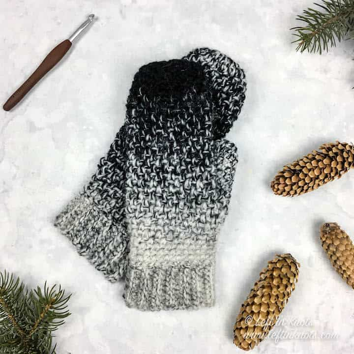 Black and white ombre crochet mittens made with the moss stitch