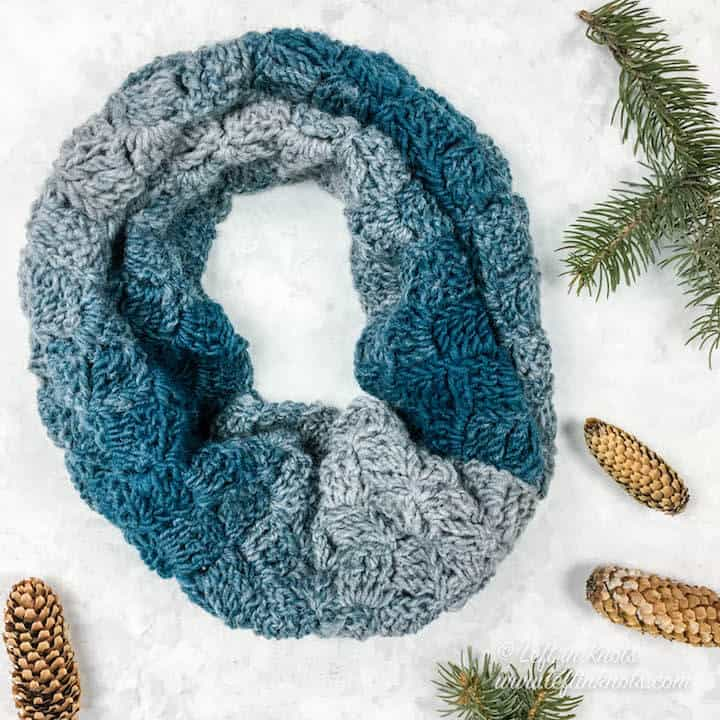 A blue and gray cowl made with one skein of yarn