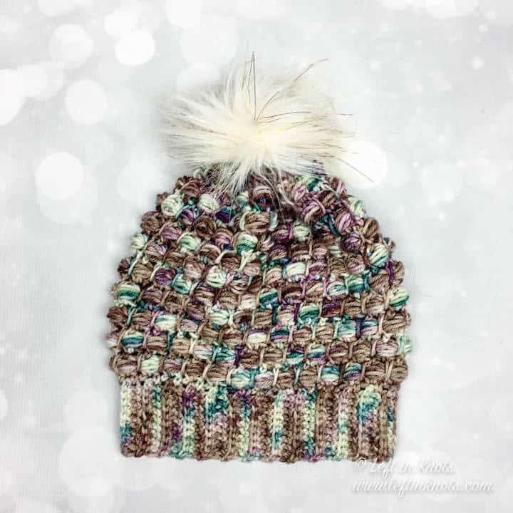 A crochet beanie made with hand dyed yarn and the bead stitch