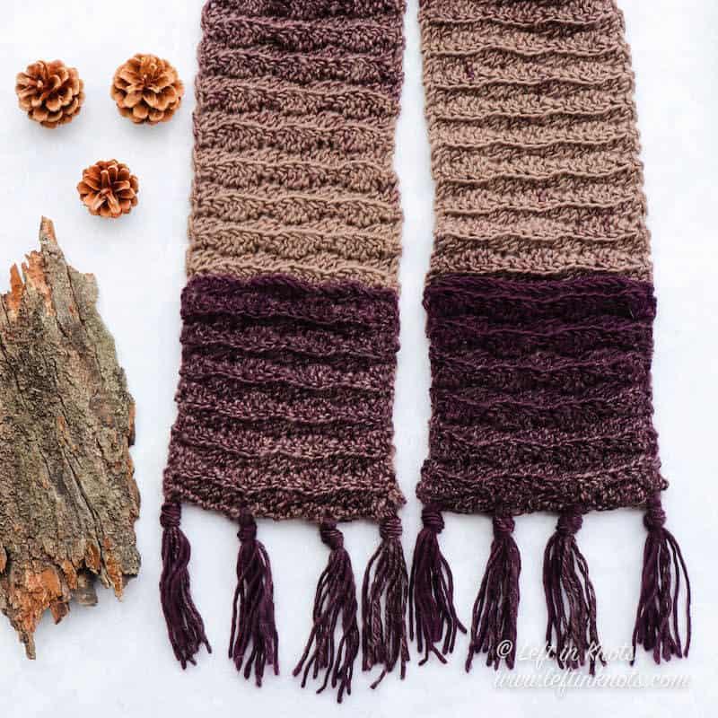 A narrow crochet pocket scarf with fringe