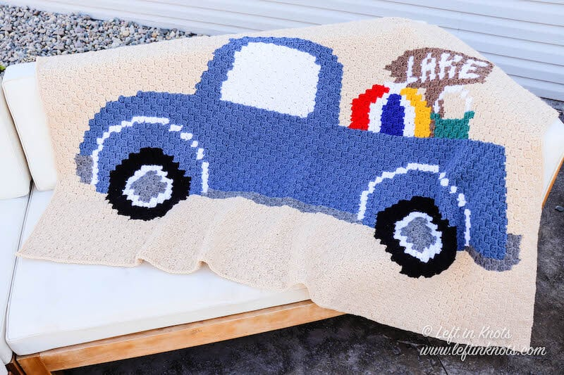 A C2C crochet blanket with a summer vintage truck