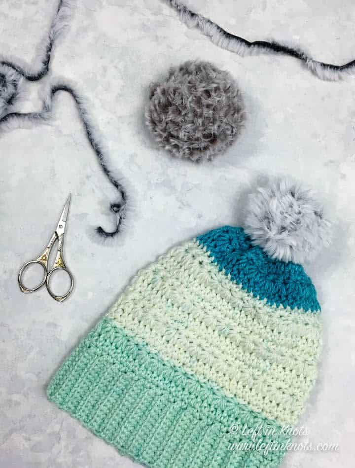 A crochet pom pom made with faux fur yarn