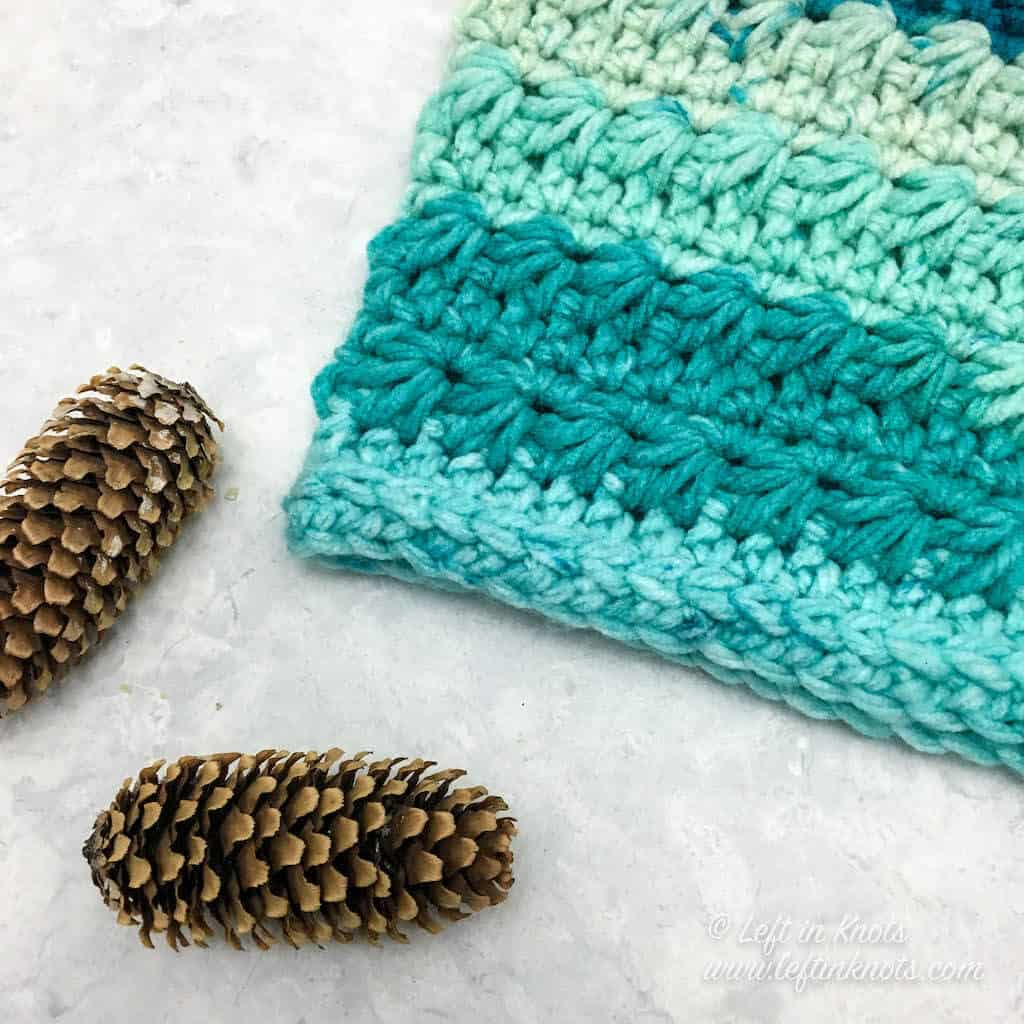 A turquoise crochet cowl made with the star stitch