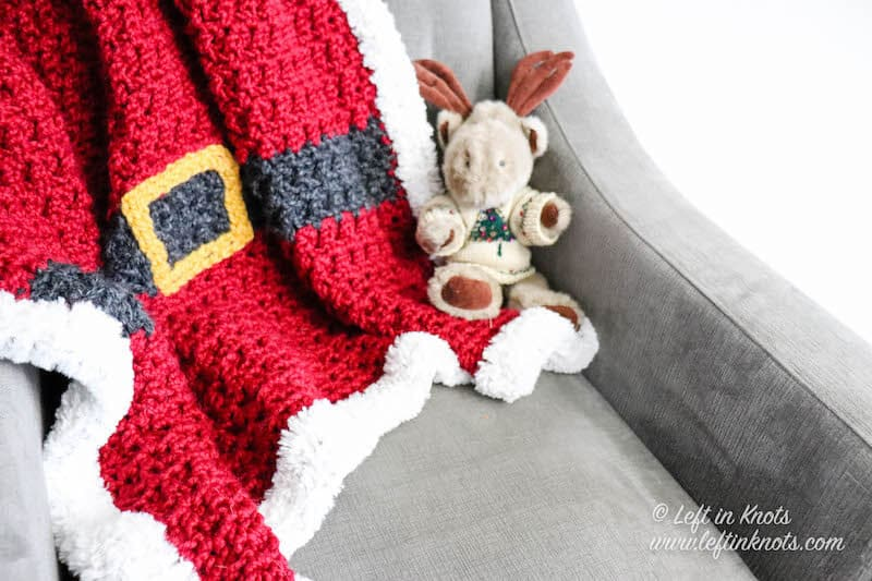 A red chunky Santa Christmas afghan with belt and fur border