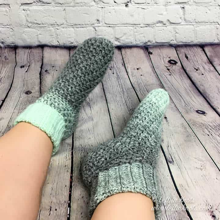 Mint and gray crochet slipper socks made with Lion Brand Scarfie yarn