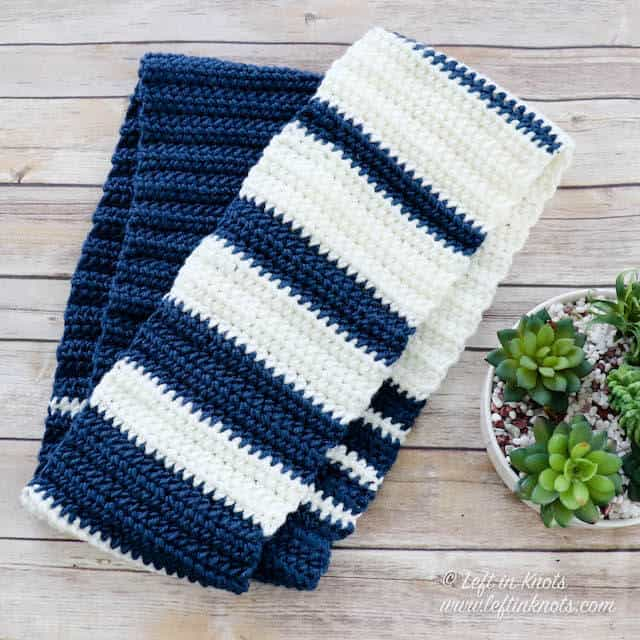 A two toned crochet infinity scarf with stripes