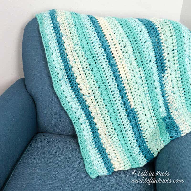 A chunky crochet blanket made with the star stitch