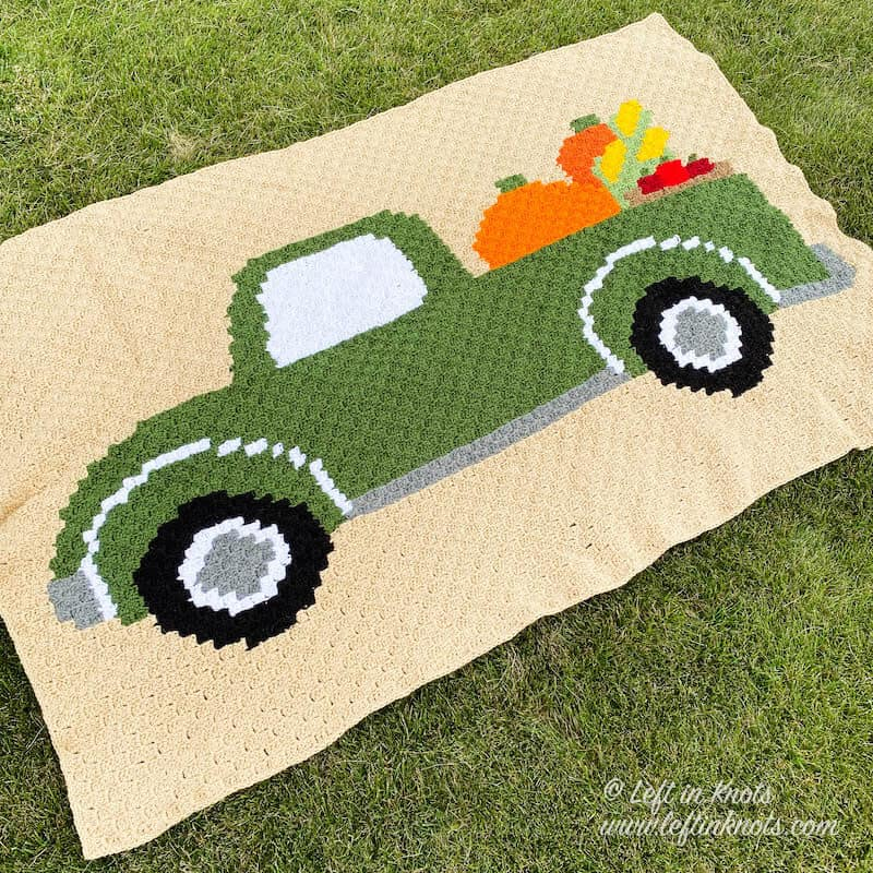 A C2C crochet blanket with a fall vintage truck and pumpkins