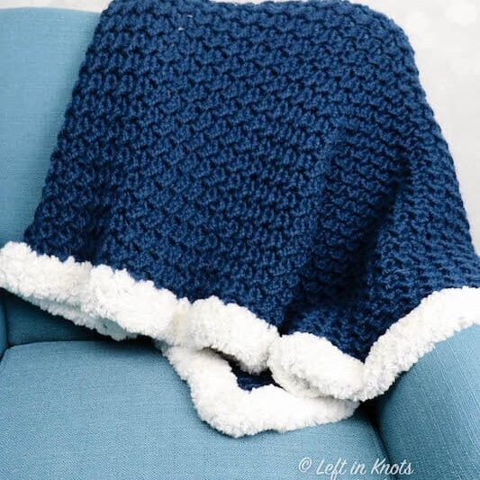 A chunky crochet throw blanket made with the crunch stitch